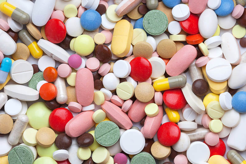Background from colored pills, tablets and capsules